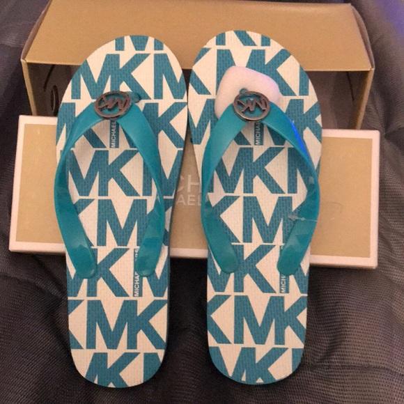 f10624914bf9 M 5a56bd77d39ca2314c00b215. Other Shoes you may like. Michael kors flat  sandals